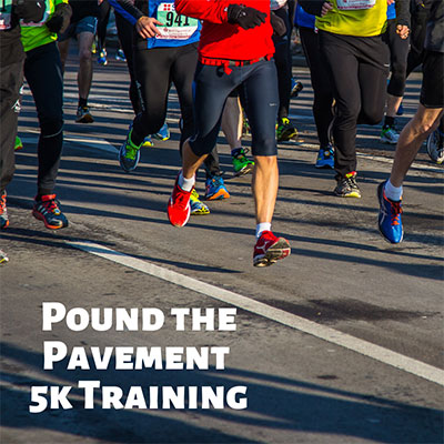 Pound the Pavement 5K Training classes with people running on road.