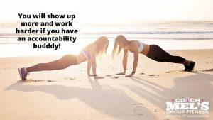 Accountability buddy workout on beach with women doing pushups.