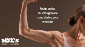 Woman flexing elbow to show toned biceps