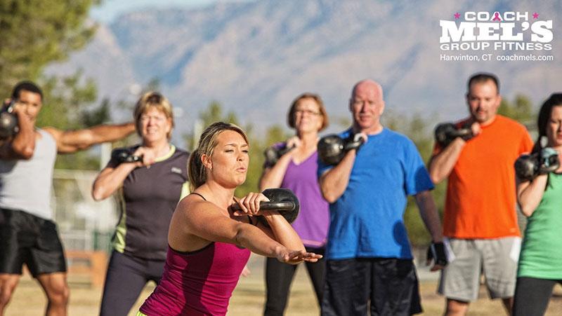 Coach Mel's group fitness kettlebell workout outdoors