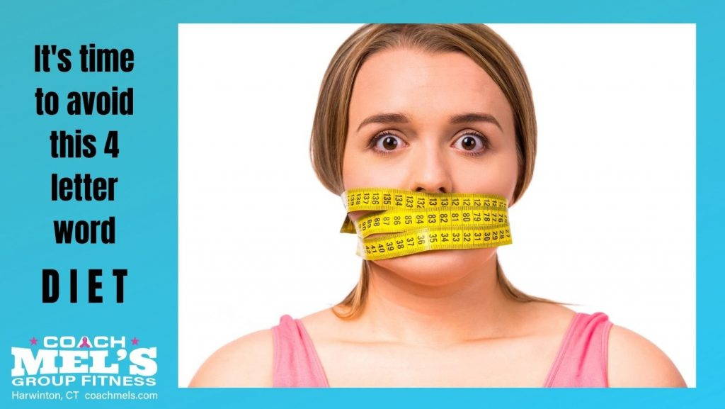 Woman with yellow fabric measuring tape wrapped around her head and mouth